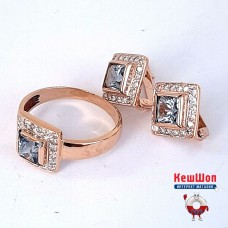 Золотой комплект с топазом (кольцо и серьги)