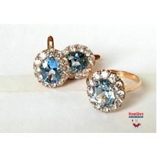 Золотой комплект с топазом (TOPAZ LONDON BLUE) и цирконием: кольцо и серьги