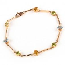 Золотой браслет с самоцветами